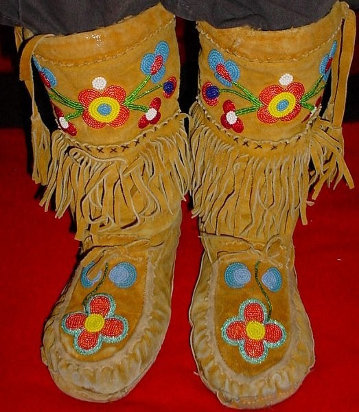 These were listed on Ebay as Vintage Métis Indian Beaded Tasseled Deer Hide Snow Moccasins. I see a lot of similiarities in style to the Métis beadwork from the H.S. Darvell estate.