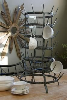 """Bottle drying rack $249.  18"""" diameter x 30"""" tall.  Made after a vintage French bottle drying rack with extreme attention to detail, this piece is a perfect showplace for glassware and cups. Each piece is handmade from Greige.com"""