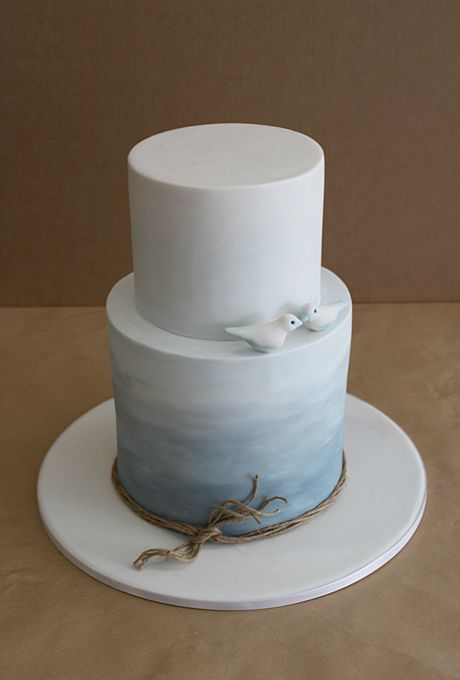 Beach-bound brides looking for a modern wedding cake should check out this design by Faye Cahill Cake Design in Sydney, Australia. The two c...