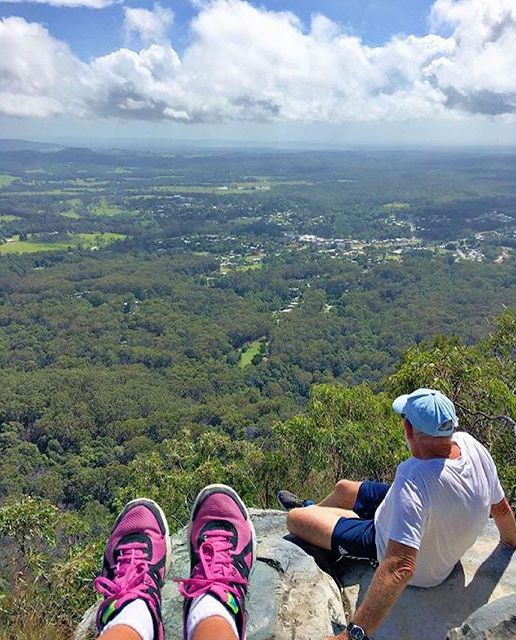Stopping for a moment to take in the views from the top of Mt Cooroora! This incredible mountain, found in the hinterland village of Pomona, rewards climbers with sweeping 360 degree views of country vistas, coastal lakes and sand dunes.