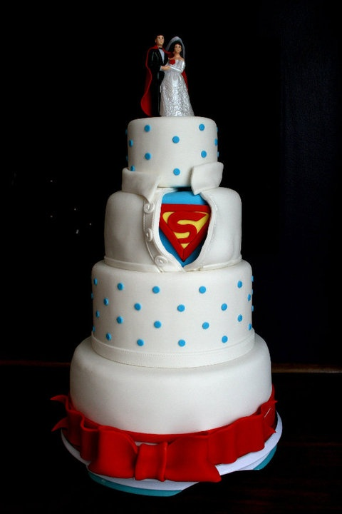 Undercover Superman wedding cake for a superhero wedding--i would be the happieset girl ever!!! i need to find my other half, one that would appreciate this!!! im such a nerd!