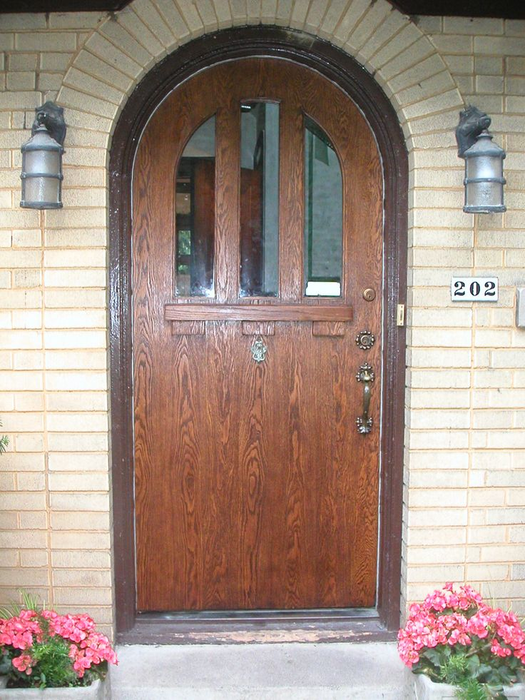 Lovely Architecture Fascinating Front Doors Design Artwork Pretty Classic Wood Door With Unique Pendant Lamp With Elegant Brown Light Brick Wall Fresh - Amazing arched entry doors Photo