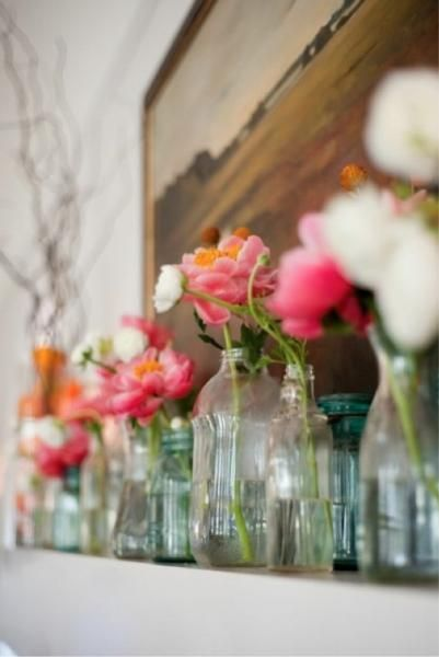 flowers in mix match glass vases and jars