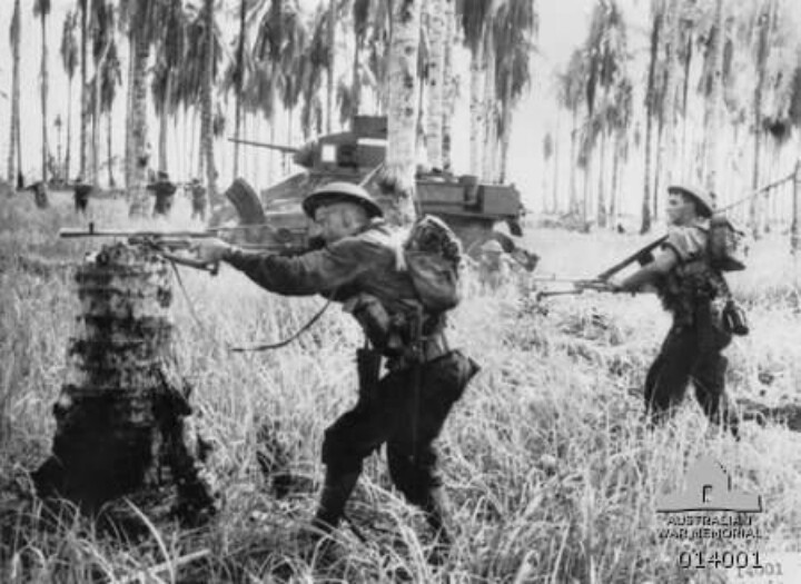 Men of D Company, 2/12th battalion fire on 25 Japanese. The pillbox was destroyed by the tanks. Photo taken by G Silk during fighting on 2 JAN 1943.