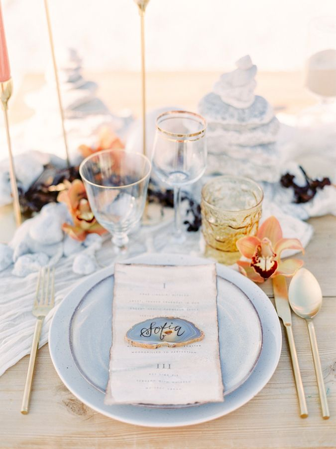 Delicate beachy table settings and geode name cards: http://www.stylemepretty.com/destination-weddings/2016/11/10/faro-inspired-wedding-shoot/ Photography: 2 Brides - http://2brides.se/