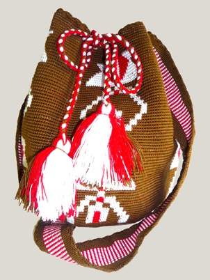 """These handmade """"Susu"""" were woven by the women of the Wayuu tribe, indigenous group to the Guajiran Peninsula region located between Venezuela and Colombia. Te Wayuu Taya is nonprofit organization founded in 2002 to help improve the lives of Latin-American indigenous communities while maintaining and respecting their traditions, culture and beliefs."""