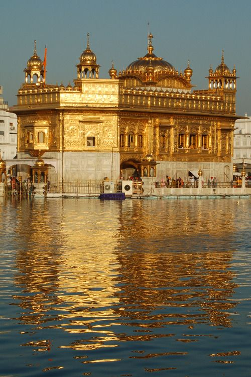 Golden Temple, Amritsar India - This Sikh Temple is covered in gold and looks like it is floating in the middle of a lake. It's beautiful when the sunset reflects off the gold. I had the amazing opportunity to visit with a Sikh friend who explained everything to me!