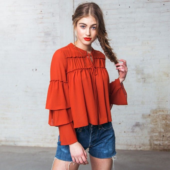Love the play on 70's bohemian chic modernized so it looks clean and simple- Gorgeous with a pair of skinny jeans.