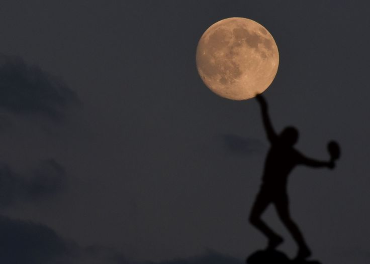 Image of the day ~ WEDNESDAY, JULY 1: WIMBLEDON The moon rises above the weather vane on June 30, 2015 at the All England Lawn Tennis and Croquet Club in London, which hosts the Wimbledon Tennis Championships.