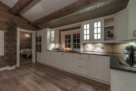 It would be a dream come true to have a cabin with walls like these and a white kitchen!