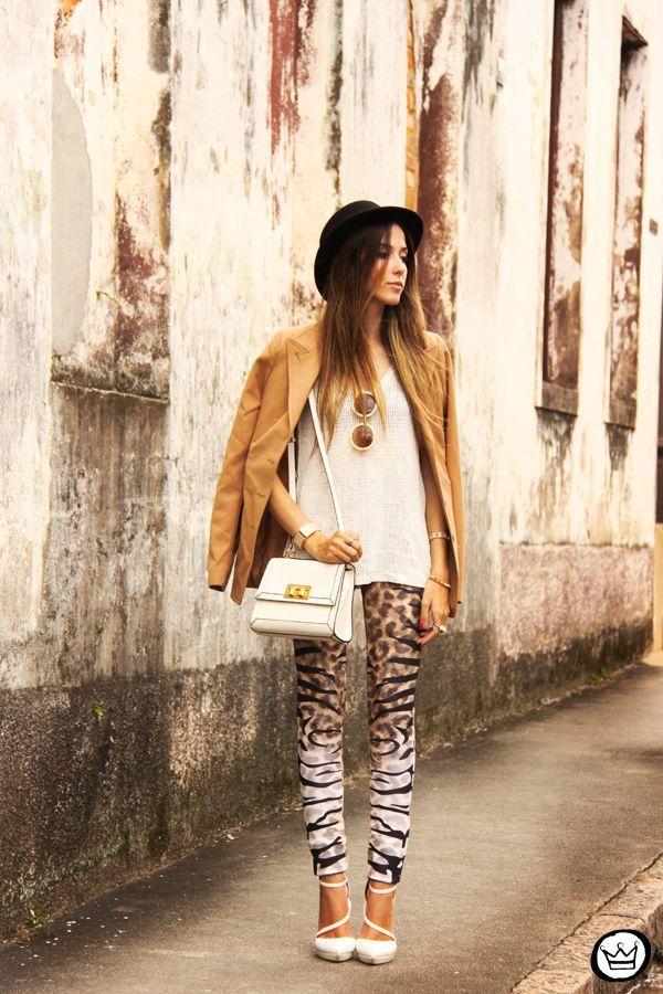 Shop this look on Lookastic:  https://lookastic.com/women/looks/blazer-sleeveless-top-leggings-pumps-satchel-bag-hat/1405  — Tan Blazer  — White Knit Sleeveless Top  — White Leather Satchel Bag  — Brown Leopard Leggings  — White Leather Pumps  — Black Hat