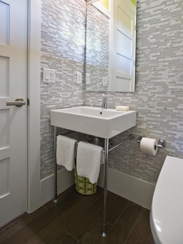Small Bathrooms That Pack a Punch: Basin legs provide extra floor space >> http://www.diynetwork.com/bathroom/small-bathrooms-that-pack-a-punch/pictures/index.html?soc=pinterest