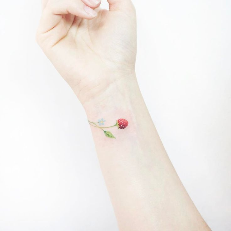 Sweet colorful strawberry tattoo on wrist
