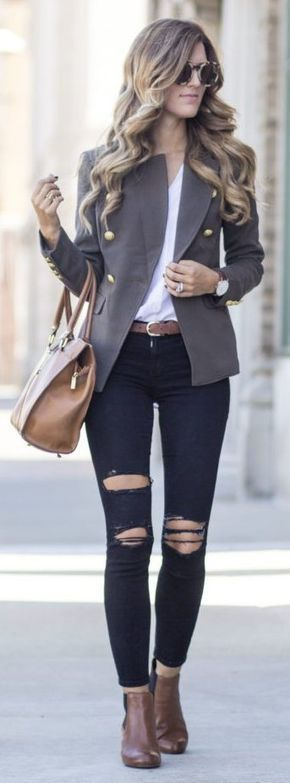 Gray blazer over white top and black jeans.