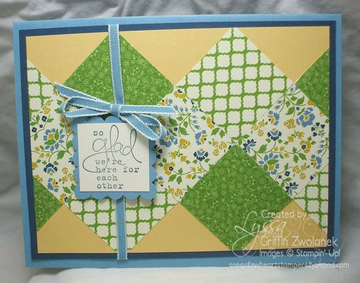handmade quilt card ... big squares of coordinating papers in green, blue and pale golden yellow ... luv how they are arranged to .look like two rows of chevons crossing each other's paths ...