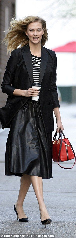 Style in black and white:She wore the wardrobe stable with a black leather A-line shirt and a tailored jacket