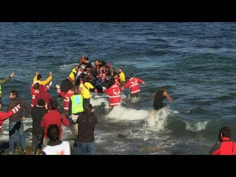 Shivering migrants arrive in Lesbos
