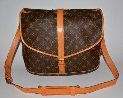 Authentic Louis Vuitton Monogram canvas Saumur 35.   Monogram canvas is without marks or wear. Cowhide strap is firm with very ight darkening, very light marks and a mark from the buckle and very light scratches. Cowhide strip on the flaps are very light darkening, very light marks from the buckle, very light scratches and very light wrinkles. Cowhide trim on the flaps are firm with small amount of very light abrasion and small amount of light darkening. Lining is without marks or wear…
