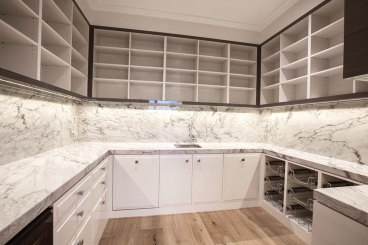 Isn't this Thunder White Granite butler's pantry something to dream about? Home by Metrobuild #cdkstone #thunderwhite #granite #thunderwhitegranite #metrobuild #dpi #lithofin #kitcheninspiration #naturalstone #lovestone #interiors