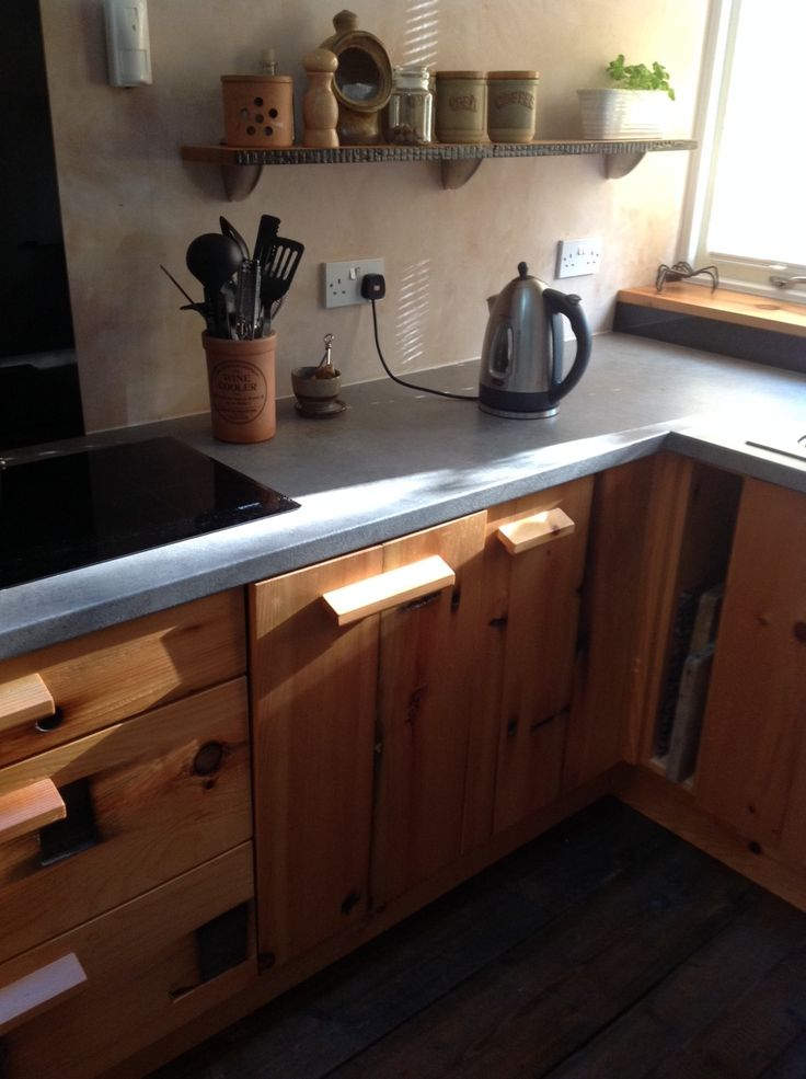 44) And a small black glass upstand under the window cill to frame the sink