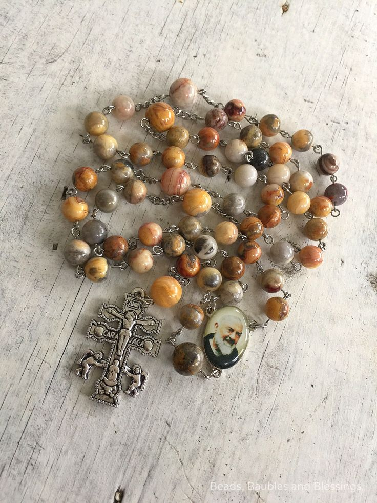 A personal favorite from my Etsy shop https://www.etsy.com/listing/233412986/caravaca-cross-rosary-saint-padre-pio
