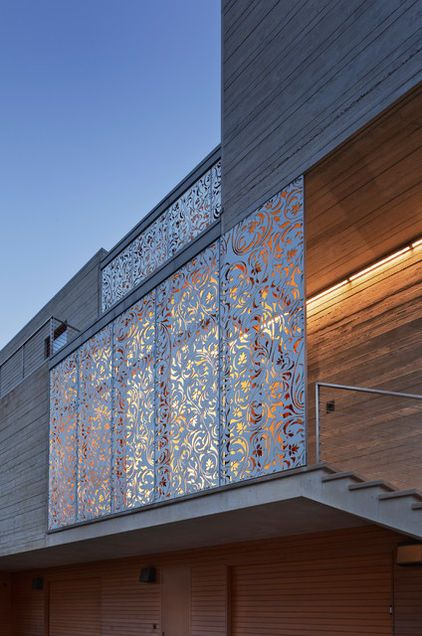 laser cut metal panels: modern exterior by aamodt / plumb architects