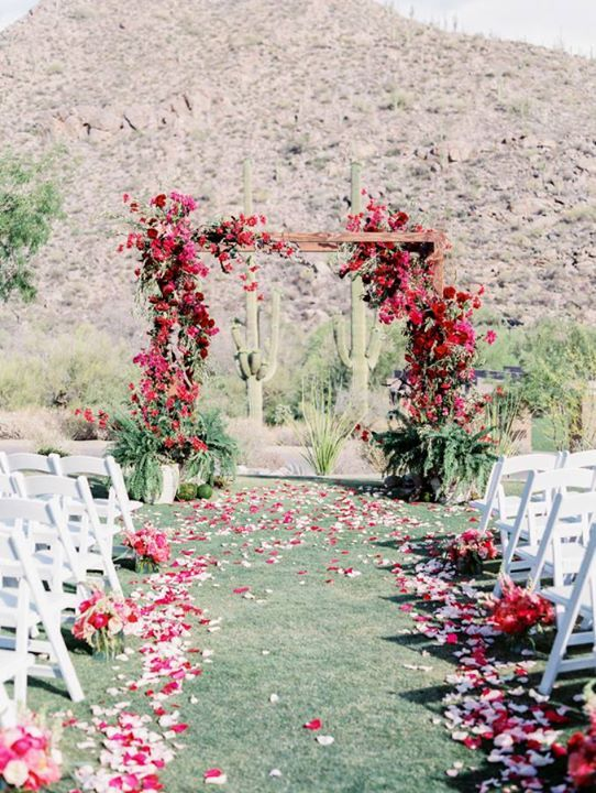 Wedding in the desert with an altar wrapped in fuchsia bougainvillea and prickly pear cacti ~ http://www.stylemepretty.com/2016/09/16/new-orleans-meets-southwest-al-fresco-arizona-wedding/