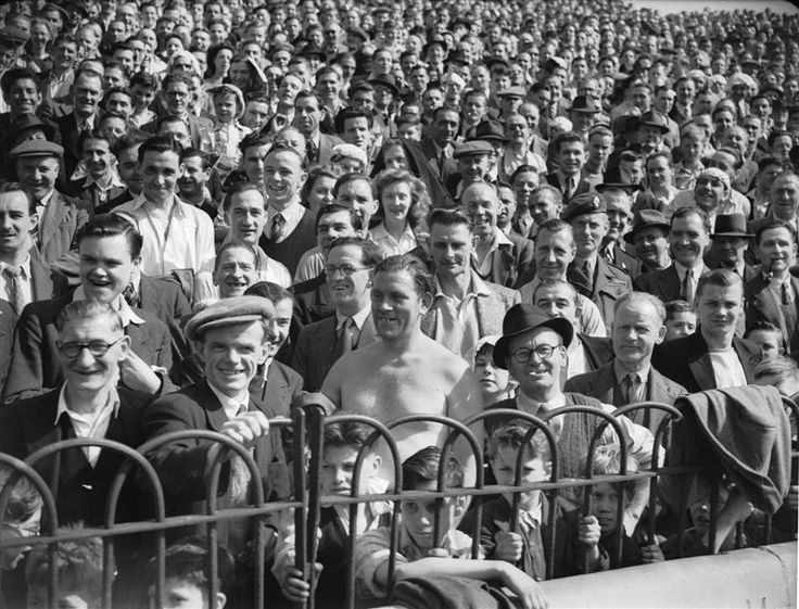 16 April 1949: Crowds watch a Chelsea versus Derby County football match at Stamford Bridge during an Easter heatwave in London...