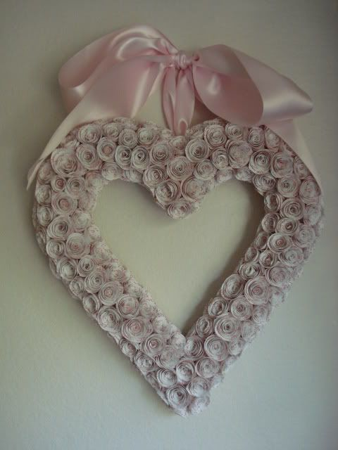 a absolutely love these wreaths with the rolled Paper Roses.....lovely,and very labor intensive but, very worth the work.