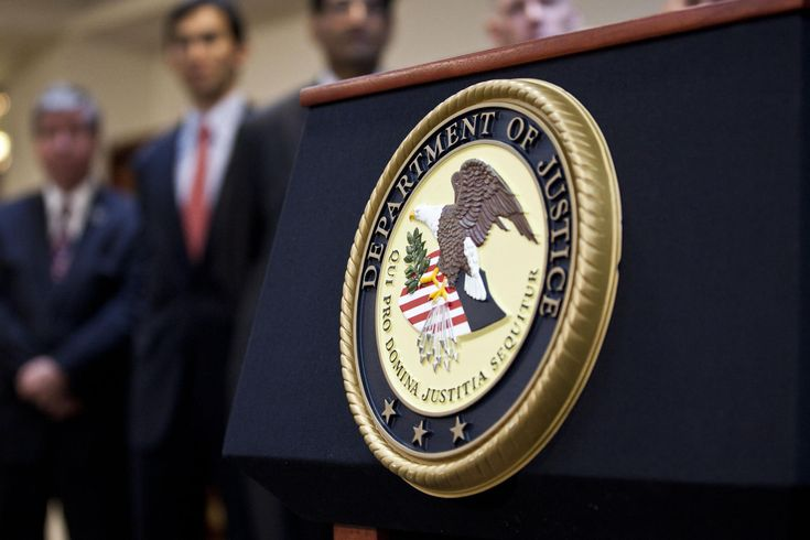 A US Department of Justice seal is displayed on a podium during a news conference on Dec. 11, 2012 in the Brooklyn borough of New York City. (Photo by Ramin Talaie/Getty)
