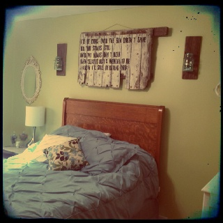 My bedroom; I painted lyrics from our unity song at our wedding unto a piece of wood from my dad's grain truck.