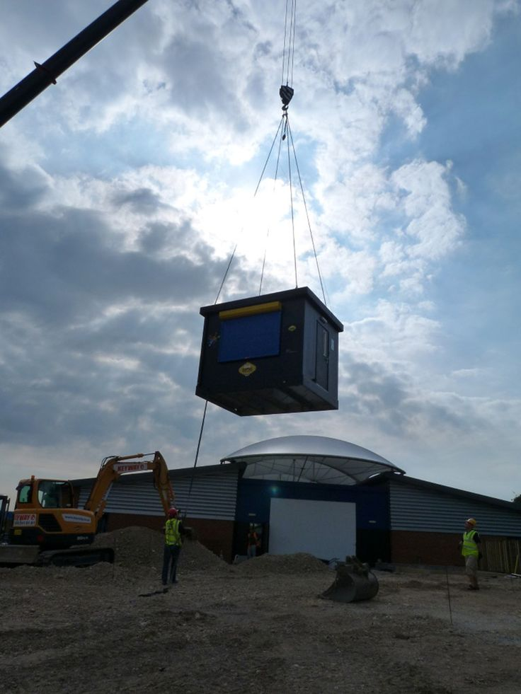 One of our Food Cubes being craned into position at Beaufort Academy. As you can see, they were undertaking building work at the time too!