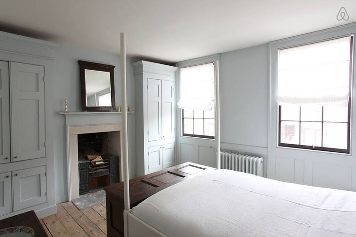 Simple, Georgian bedroom. One colour walls, cupboards, fireplace.