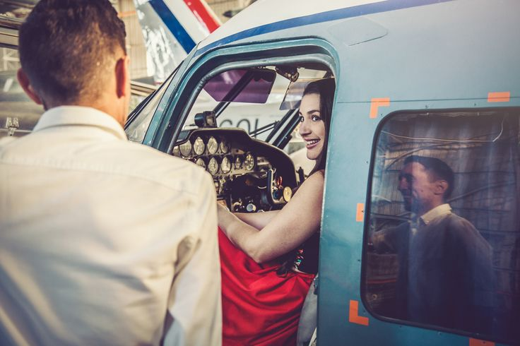 Engagement shoot in airplane hanger