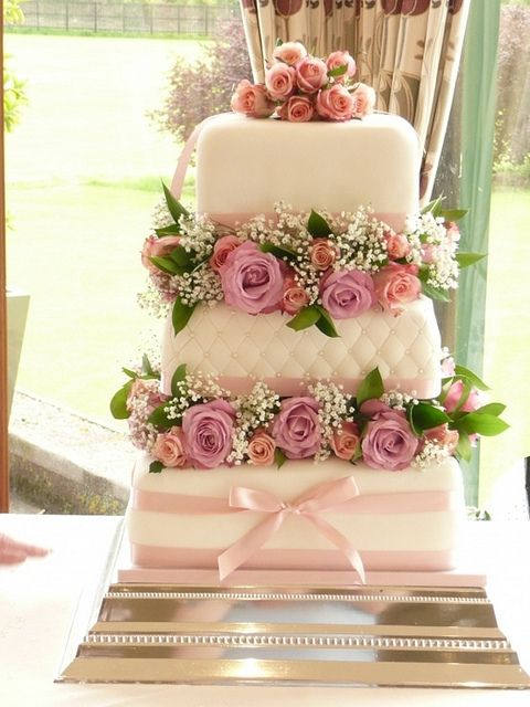 Perfection.  Lovely shape and the flowers between the layers are gorgeous.  The stand is perfect and accentuates the cake so nicely.