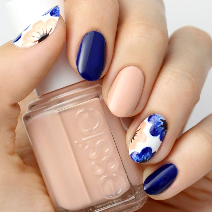 Whether you're going on a sunny getaway, or are attending a summer gala, this nude and navy blue floral nail will get you in the mood for fun festivities!