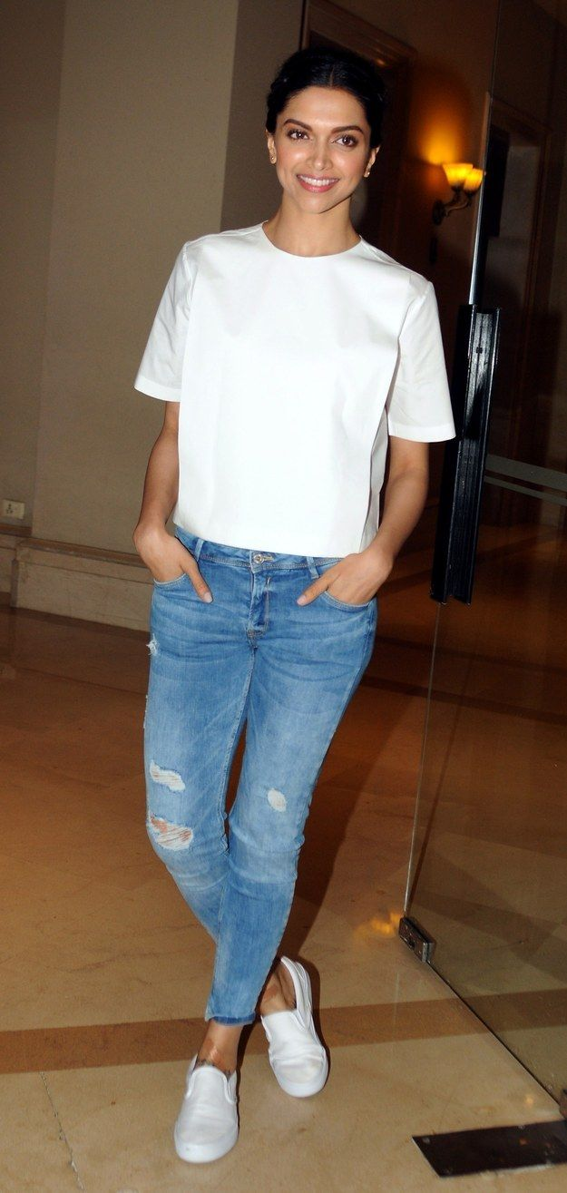 And here she is, looking just as radiant, in the classic white shirt–blue jeans combo. | Just Making Sure Everyone In The World Knows That Deepika Padukone Is A Flawless Goddess