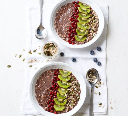 A healthy, summery vegan porridge with jumbo oats and bright pink pomegranate seeds
