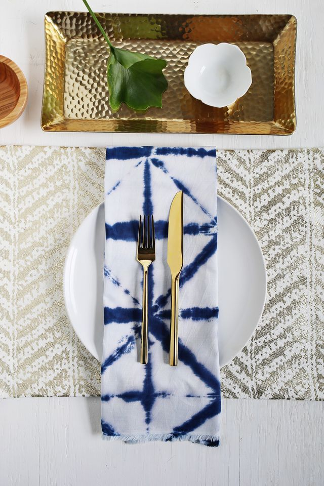 Shibori tie-dye dinner napkins give you that indigo effect without the big hastle. Get the full tutorial over at www.aBeautifulMess.com