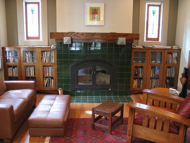 Built Ins And Green Tile Fireplace