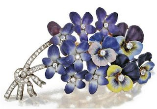 Enameled Pansy brooch in a myriad of blues, lavenders, and chartreuse. The stems are designed in diamonds with a diamond string keeping them all together.