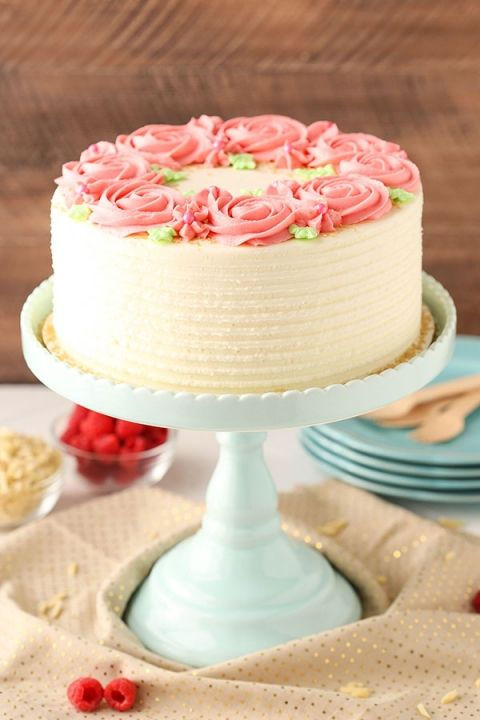 Raspberry Almond Layer Cake! Such a light, moist cake with fresh raspberry frosting!