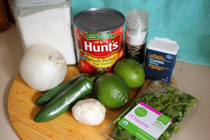 Restaurant Salsa Roughly chop your onion, and jalapeno.  Add the whole can of tomatoes, including juice, your chopped veggies, roughly chopped garlic, cumin, salt, sugar, a handful or more of cilantro, and juice some limes into your food processor.