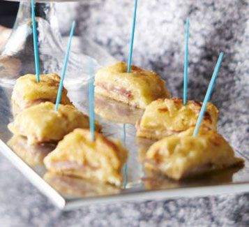 Turn a comfort food classic into a cute canapé with these mini melted cheese and ham toasties on cocktail sticks - perfect for a party or buffet