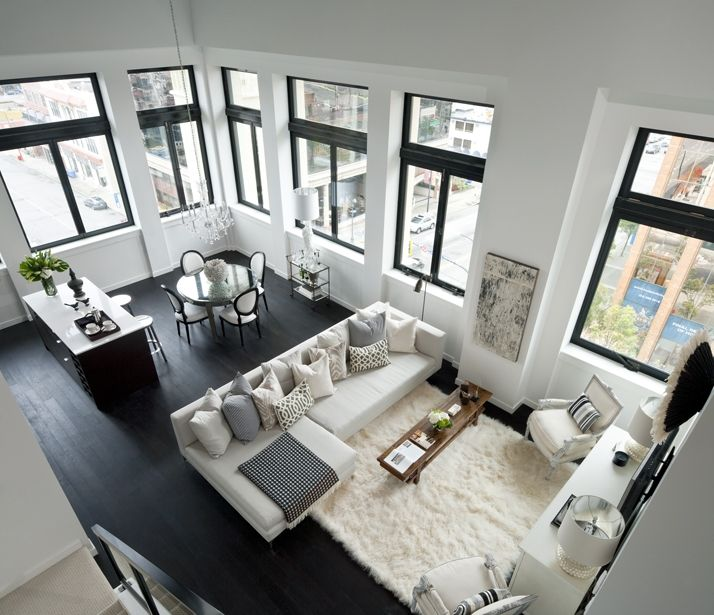 Great black/white. Love the traditional dining chairs, awesome windows (transoms!) and dark floors.