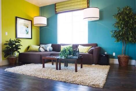 Bold colour combinations such as this Diad teal and cool yellow only need neutral furniture, flooring and rug.