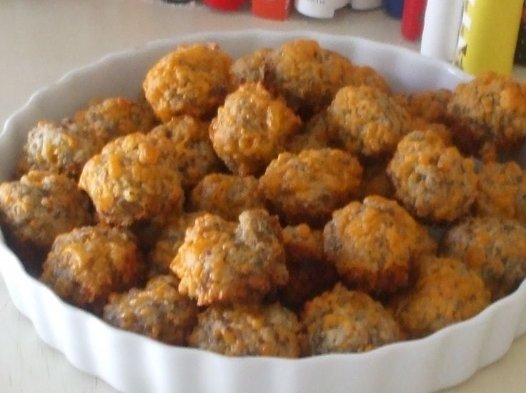 Sausage balls-     Ingredients    1 lb Jimmy Dean sausage, uncooked    2 cups of Bisquick baking mix    3 cups sharp chedder cheese shredded  Preheat oven to 350 degrees.    Mix all three of the above together and then roll into 1 inch balls. Place on an ungreased cookie sheet and bake in the oven for 25 minutes.