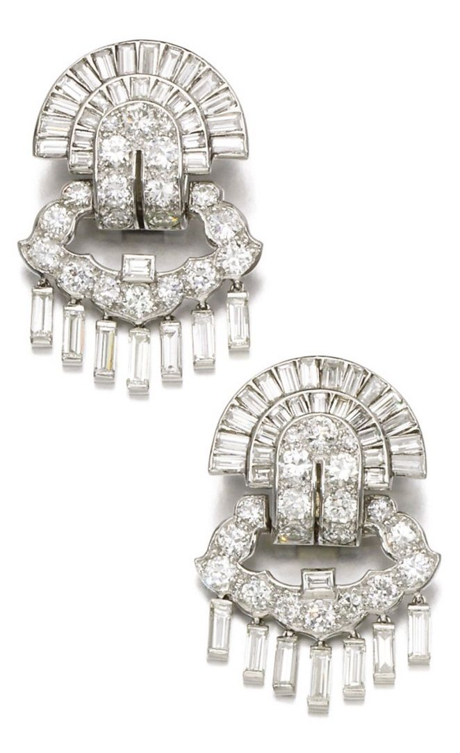 A pair of Art Deco diamond earrings, Cartier, 1930s. Each articulated earring of radiating and fringe design, set with circular-cut and baguette diamonds, post and hinged back fittings, each signed Cartier, indistinctly numbered. #Cartier #ArtDeco #earrings