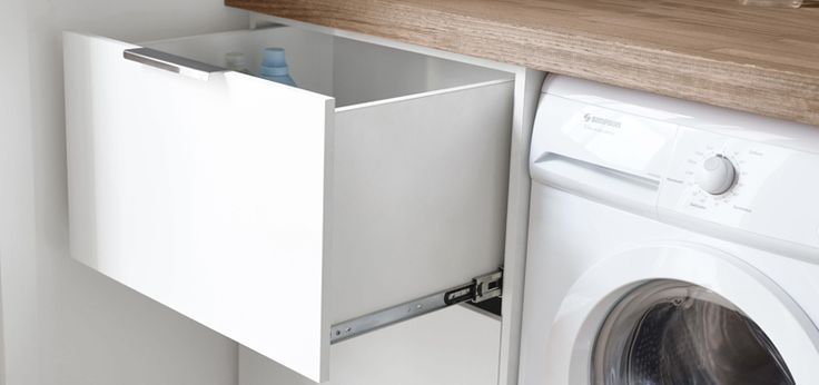 Laundry cabinet Use the space below  If you can't go above, you can always go below. Create storage next to or under your dryer and washing machine by installing a cabinet. Or, you can use