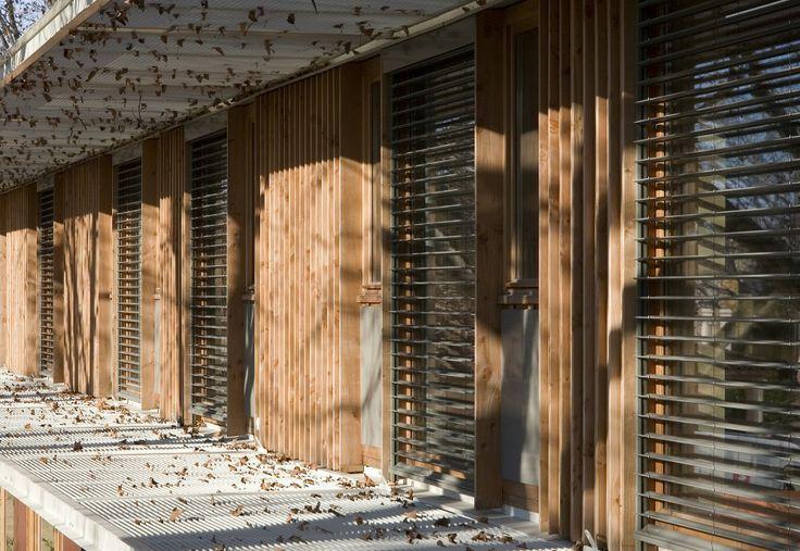 Jean Carrière Nursery School - vertical cladding + horizontal louvres